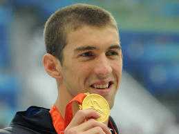 Michael Phelps with his gold medal after winning the men's 200m butterfly at Beijing 2008.