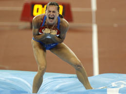 Yelena Isinbayeva celebrates winning pole vault gold at Beijing 2008.