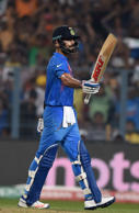 File: India's Virat Kohli celebrates after scoring a half-century (50 runs)during the World T20 cricket tournament match between India and Pakistan at The Eden Gardens Cricket Stadium in Kolkata on March 19, 2016.