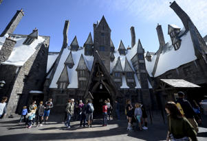"Guests walk through Hogsmeade Village during a soft opening and media tour of ""The Wizarding World of Harry Potter"" theme park at the Universal Studios Hollywood in Los Angeles:"