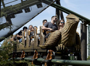 "Guests take a ride on a rollercoaster outside the Hogwarts School during a soft opening and media tour of ""The Wizarding World of Harry Potter"" theme park at the Universal Studios Hollywood in Los Angeles:"