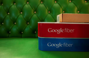 Google Fiber boxes rest on a sofa in the home of Becki Sherwood November 27, 2012 in Kansas City, Kansas. Sherwood's neighborhood was the first to receive Google Fiber.