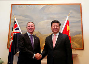 China's President Xi Jinping shakes hand with New Zealand's Prime Minister John Key at bilateral talks in Wellington, November 20, 2014