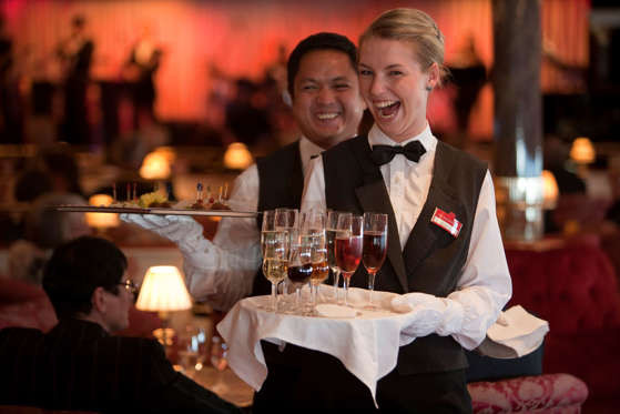 Waiter staff serving drinks and canapes