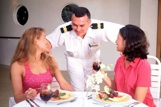 Passengers talk with food and  beverage manager