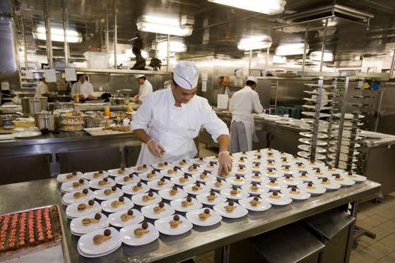 Pastry chefs preparing desserts