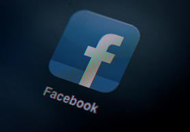 A logo for Facebook Inc.'s app is seen on an Apple Inc. iPad in this arranged photograph in London, U.K., on Monday, May 14, 2012.