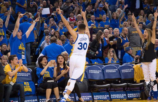 Golden State Warriors guard Stephen Curry (30) celebrates after making his 400th three-point basket against the Memphis Grizzlies on April 13 in Oakland. The Warriors defeated the Grizzlies 125-104.
