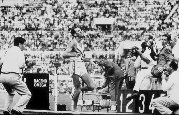 Herb Elliott of Australia finishes the 1500 meters final at the 1960 Olympic Games in Rome in a world record time of 3 minutes 35.6 seconds.