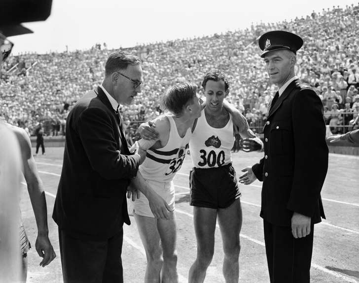 England's Dr. Roger Bannister, left, puts arm around the shoulders of Australia's John Landy after the mile run in British Empire games at Vancouver, B.C. on August 9, 1954. Bannister won race in 3:58.8 while Landy finished second with a 3:59.6 clocking.