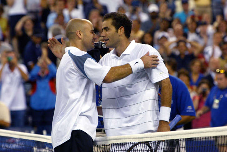 Andre Agassis (L) congratulates Pete Sampras after Sampras defeated Agassi at the finals of the US Open on Sept. 8, 2002. Sampras, the No. 17 seed, beat No. 6 Agassi 6-3, 6-4, 5-7, 6-4 for first U.S. Open title since 1996 and his first tournament title of any kind since Wimbledon 2000, a span of 33 events.