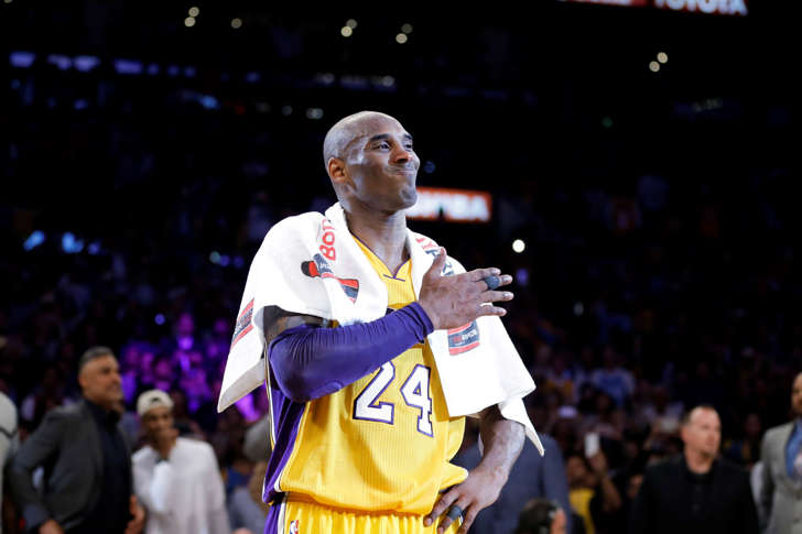 Los Angeles Lakers' Kobe Bryant pounds his chest after the last NBA basketball game of his career against the Utah Jazz, Wednesday, April 13, 2016, in Los Angeles.