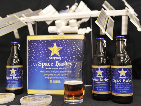 (FILES) <strong>This file photo taken on December 3, 2009 shows Japan's Sapporo Breweries displaying bottles of 'Space Barley' beer, the world's first beer brewed from seedlings of bareleycorn that travelled to the Russian space station, during a press conference in Tokyo. Sapporo Breweries Ltd. said on December 7, 2009 orders had flooded in for the special edition of 250 six-packs of its new 'Space Barley.'</strong> AFP PHOTO / FILES / Yoshikazu TSUNO (Photo credit should read YOSHIKAZU TSUNO/AFP/Getty Images)