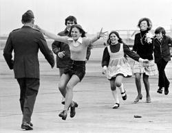 Released prisoner of war Lt. Col. Robert L. Stirm is greeted by his family at Travis Air Force Base in Fairfield, Calif., as he returns home from the Vietnam War, March 17, 1973. In the lead is Stirm's daughter Lori, 15; followed by son Robert, 14; daughter Cynthia, 11; wife Loretta and son Roger, 12. (AP Photo/Sal Veder)