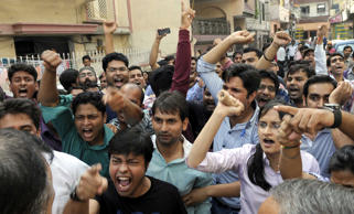 File: Indian foreign medical students who have received their medical degrees abroad protest against the Foreign Medical Graduates Examination or the MCI screening test in front of the Union Health Minister Dr. Harsh Vardhan's house, demanding that the Medical Council of India (MCI) withdraw what they termed was its unfair screening exam, on August 20, 2014 in New Delhi, India.