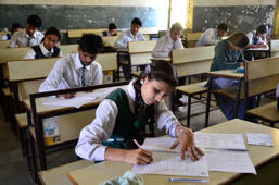 File: Students appear for the CBSE class 12th examinations at Govt. Subhash School of Excellence on March 1, 2016 in Bhopal, India.