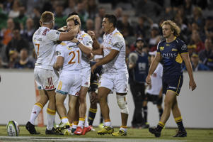 Damien McKenzie of the Chiefs celebrates with team mates after scoring a try during the Round 5 Super Rugby match between the ACT Brumbies and the Chiefs at GIO Stadium in Canberra, Saturday, April 2, 2016.
