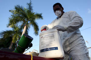 A health worker prepares insecticide before fumigating a neighborhood in San Juan, in this January 27, 2016, file photo.