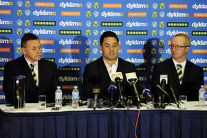 Jarryd Hayne speaks at a press conference with Eels CEO Scott Seward (R) and Eels Chairman Steve Sharp (L) to announce he is quitting the NRL to pursue NFL in America on October 15, 2014 in Parramatta, Australia