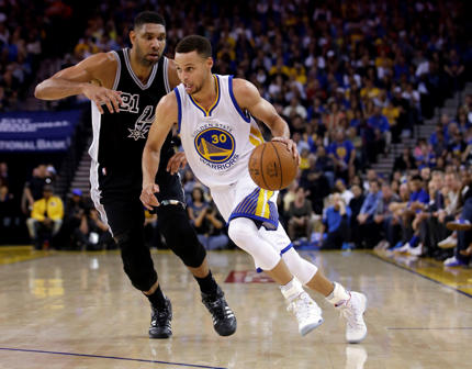 Warriors' Stephen Curry (30) dribbles past Spurs' Tim Duncan during the first half of an NBA basketball game Thursday, April 7, 2016, in Oakland, Calif.