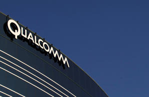 In this November 2011 file photo, a sign sits atop the Qualcomm headquarters bui...