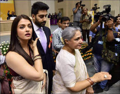 <p>The couple waits for Amitabh Bachchan along with mom Jaya Bachchan. (Source: PTI)</p>