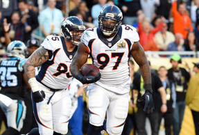 Denver Broncos defensive end Malik Jackson celebrates after recovering a fumble for a touchdown against the Carolina Panthers in Super Bowl 50 at Levi's Stadium.