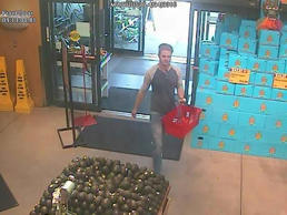 Surveillance images show the man walking through the Whole Foods in Ann Arbor on...