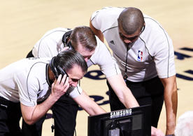 Referees review a play prior to ejecting Al Horford #15 of the Atlanta Hawks from the game for a flagrant foul in the second quarter against the Cleveland Cavaliers during Game Three of the Eastern Conference Finals of the 2015 NBA Playoffs at Quicken Loans Arena on May 24, 2015 in Cleveland, Ohio.
