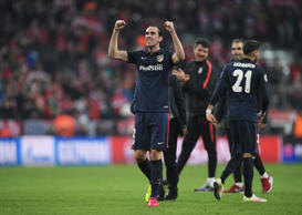 File: Diego Godin of Atletico Madrid celebrates with team mates after the UEFA Champions League semi final second leg match between FC Bayern Muenchen and Club Atletico de Madrid at Allianz Arena on May 3, 2016 in Munich, Germany.