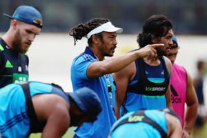 Head coach Tana Umaga of the Blues gives instructions to the team during a Blues super rugby training session at Alexander Park on February 2, 2016 in Auckland, New Zealand