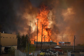Flames rise in Industrial area south Fort McMurray, Alberta Canada May 3, 2016. The whole city of Fort McMurray, Alberta, the gateway to Canada's oil sands region, is under a mandatory evacuation order because of an uncontrolled wildfire that is rapidly spreading, local authorities said on Tuesday. Courtesy CBC News/Handout via REUTERS