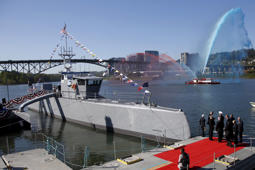 "The autonomous ship ""Sea Hunter"", developed by DARPA, is shown docked in Portland, Oregon after its christening ceremony April 7, 2016."