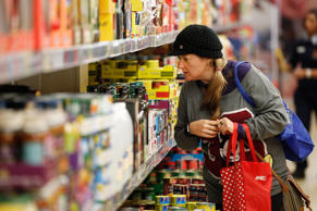 A customer browses a display of canned products at an Aldi Stores Ltd. food store in Sydney.
