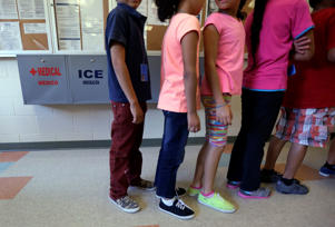 In this Sept. 10, 2014 file photo, detained immigrant children line up in the cafeteria at the Karnes County Residential Center in Karnes City, Texas.