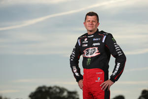 Garth Tander driver of the #2 Holden Racing Team Holden poses during a V8 Supercars portrait session on February 22, 2016 at the Winton International Raceway in Benalla, Australia