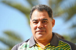 Kangaroos coach Mal Meninga watches on during the Australia Kangaroos Test team photo session at Crowne Plaza Coogee on May 2, 2016 in Sydney, Australia