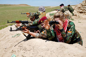 Iraqi Kurdish female fighter Haseba Nauzad (2nd R), 24, and Yazidi female fighter Asema Dahir (3rd R), 21, aim their weapon during a deployment near the frontline of the fight against Islamic State militants in Nawaran near Mosul, Iraq, April 20, 2016.