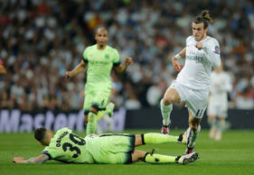 File: Manchester City's Nicolas Otamendi slides in to challenge Real Madrid's Gareth Bale during the Champions League semifinal second leg soccer match between Real Madrid and Manchester City at the Santiago Bernabeu stadium in Madrid, Wednesday May 4, 2016.