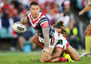 Shaun Kenny-Dowall of the Roosters is tackled during the round eight NRL match between the St George Illawarra Dragons and the Sydney Roosters at Allianz Stadium on April 25, 2016 in Sydney, Australia