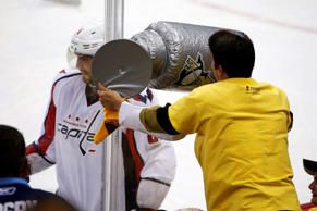 A Pittsburgh Penguins fan waves an inflatable Stanley Cup at the Washington Capitals' Alex Ovechkin during the third period of Game 4 in the Eastern Conference semifinals on May 4, 2016.