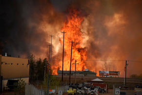 File: Flames rise in Industrial area south Fort McMurray, Alberta Canada May 3, 2016.