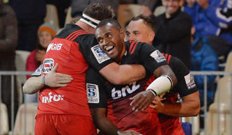 Jone Macilai of the Crusaders (C) and his teammates celebrate scoring a try during the round 11 Super Rugby match between the Crusaders and the Reds at AMI Stadium on May 6, 2016 in Christchurch, New Zealand