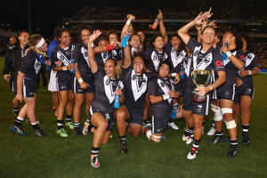 The Kiwi Ferns celebrate with the trophy after victory during the Women's international Rugby League Test match between the Australian Jillaroos and New Zealand Kiwi Ferns at Hunter Stadium on May 6, 2016 in Newcastle, Australia