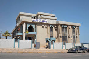 A man walks out of a bank in the city of Derna