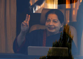 File: J. Jayalalithaa, chief minister of India's Tamil Nadu state and chief of Anna Dravida Munetra Khazhgam (AIADMK), gestures from inside a vehicle after addressing her party supporters during an election campaign rally in the southern Indian city of Chennai, on April 19, 2014.