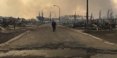 A Mountie surveys the damage on a street in Fort McMurray, Alberta, Canada in this twitter image posted on May 5, 2016.