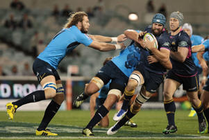 Scott Fardy of the Brumbies is tackled during the round 11 Super Rugby match between the Brumbies and the Bulls at GIO Stadium on May 6, 2016 in Canberra, Australia