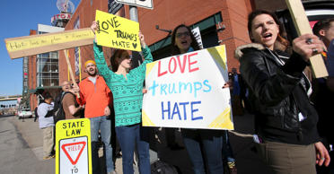 Protesters chant and hold up signs outside the Convention Center prior to Republican U.S. presidential candidate Donald Trump speaking at a campaign rally in Pittsburgh on April 13, 2016.