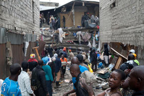 People help survivors retrieve their household items at the site of a building collapse in Nairobi, Kenya, Saturday, April 30, 2016. A six-storey residential building in a low income area of the Kenyan capital collapsed Friday night under heavy rain and flooding, killing at least seven people and injuring over 100 others, Kenyan officials said.